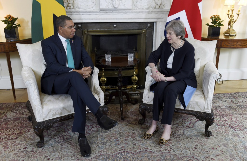Britain's Prime Minister Theresa May and Prime Minister of Jamaica Andrew Holness speak during a bilateral meeting at 10 Downing Street, London, Tuesd