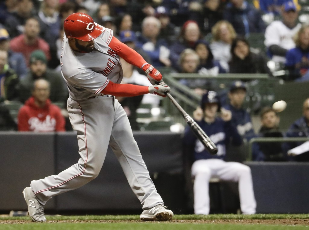 Cincinnati Reds' Jose Peraza hits a two-run scoring double during the sixth inning of a baseball game against the Milwaukee Brewers Monday, April 16,