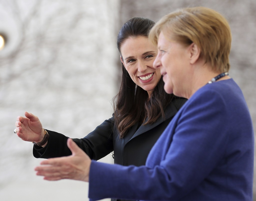 German Chancellor Angela Merkel welcomes New Zealand's Prime Minister Jacinta Ardern prior to a meeting in the chancellery in Berlin Tuesday, April 17