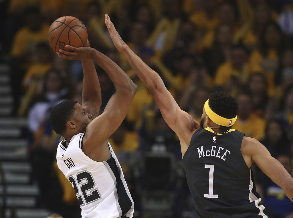 San Antonio Spurs' Rudy Gay, left, shoots against Golden State Warriors' JaVale McGee (1) during the first quarter in Game 2 of a first-round NBA bask