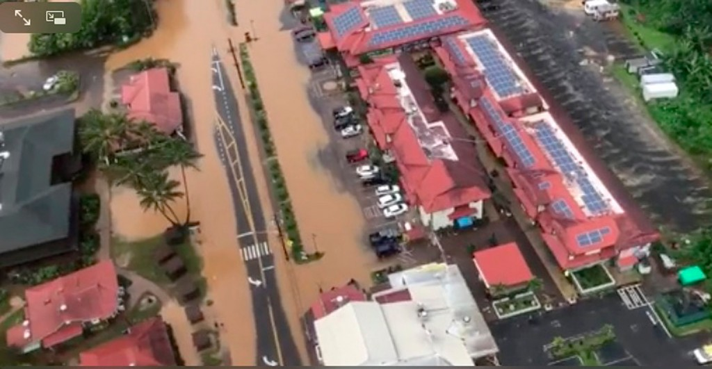 This image taken from video provided by the U.S. Coast guard shows flooding in Kauai's Hanalei Bay, Hawaii, Sunday, April 15, 2018. Hawaii Gov. David