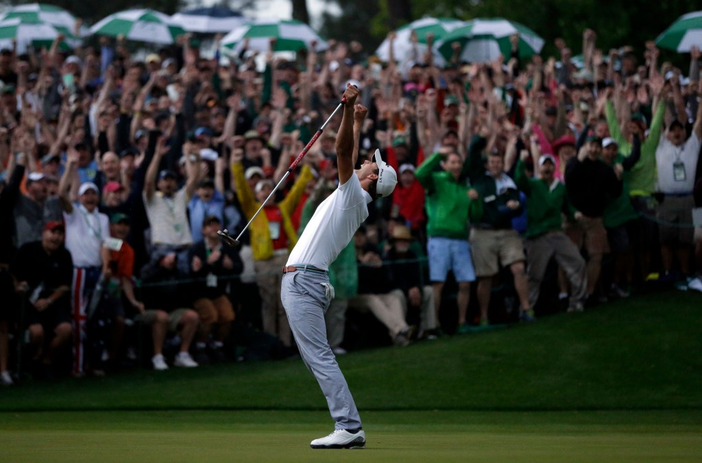 FILE - In this April 14, 2013, file photo, Adam Scott, of Australia, celebrates after making a birdie putt on the second playoff hole to win the Maste