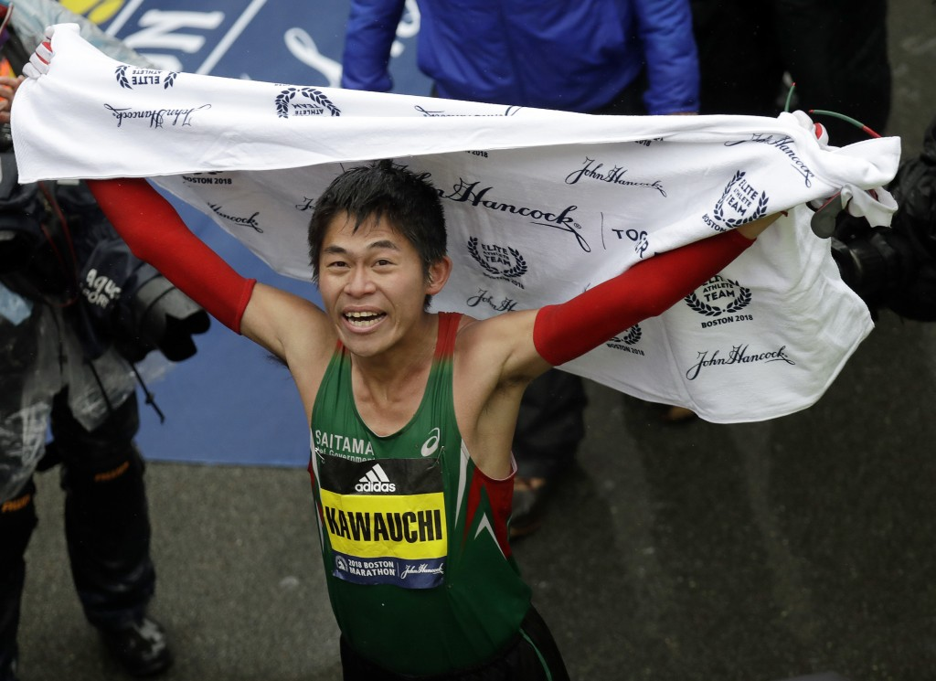 Yuki Kawauchi, of Japan, celebrates after winning the 122nd Boston Marathon on Monday, April 16, 2018, in Boston. He is the first Japanese man to win
