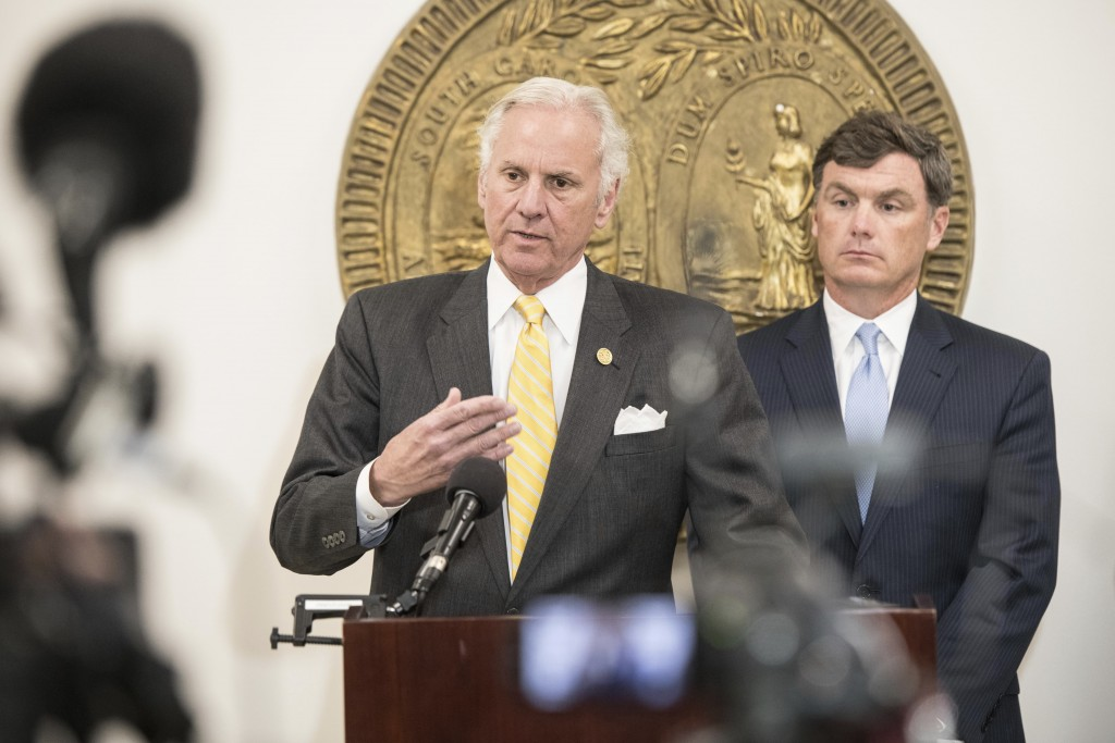 South Carolina Gov. Henry McMaster, left, and South Carolina Department of Corrections Director Bryan Stirling address the media at a press conference