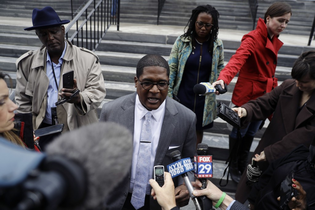Bill Cosby's spokesman Andrew Wyatt speaks to the media outside the Montgomery County Courthouse during a break in Cosby's sexual assault retrial, Mon