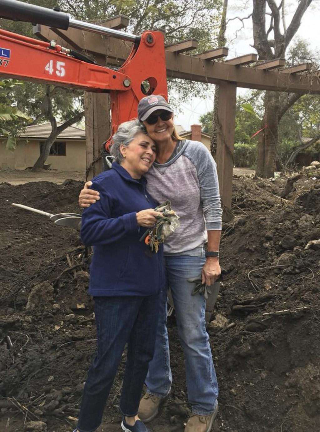 In this April 3, 2018, photo, provided by Sherri Ball, Mari Mitchel, left, poses for a photo with Ann Burgard, the woman who found her jewelry, near t
