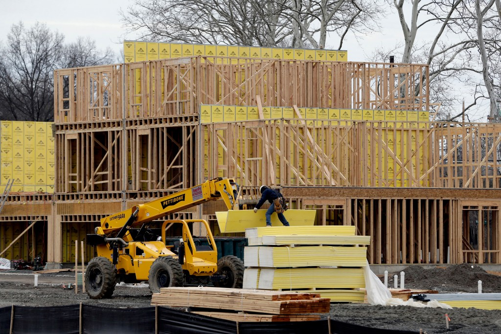 FILE- In this Feb. 26, 2018, file photo, work continues on a new development in Fair Lawn, N.J. On Tuesday, April 17, the Commerce Department reports