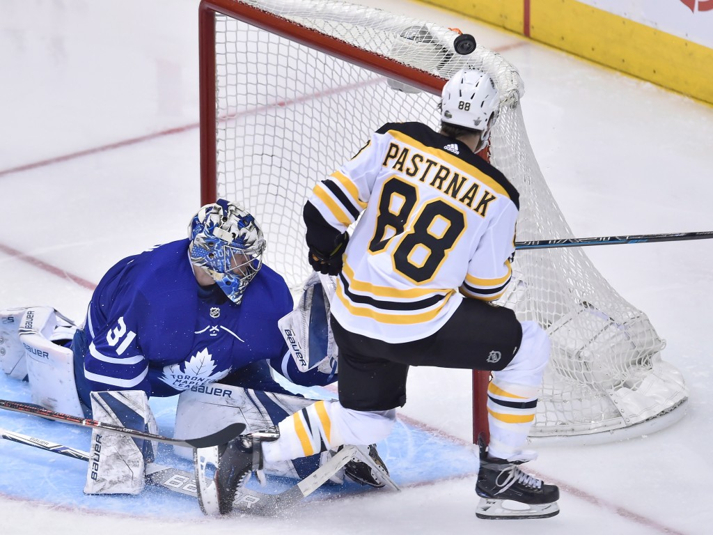 Toronto Maple Leafs goaltender Frederik Andersen (31) makes a save on Boston Bruins right wing David Pastrnak (88) as the pucks goes over the net duri