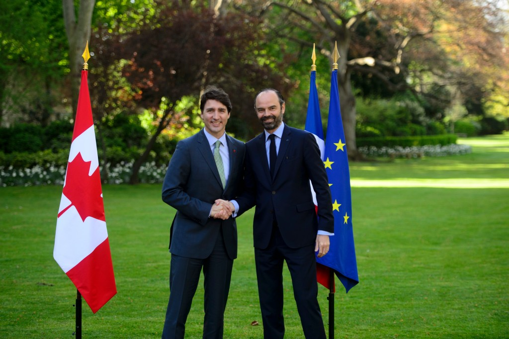 Canada's Prime Minister Justin Trudeau, left, meets with Prime Minister of France Edouard Philippe in Paris, France on Tuesday, April 17, 2018. (Sean