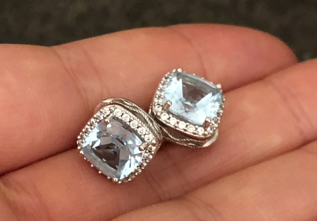 This Jan. 14, 2018, photo provided by Erin Doherty shows the blue diamond earrings she found on the beach a couple days after the mudslides in Monteci