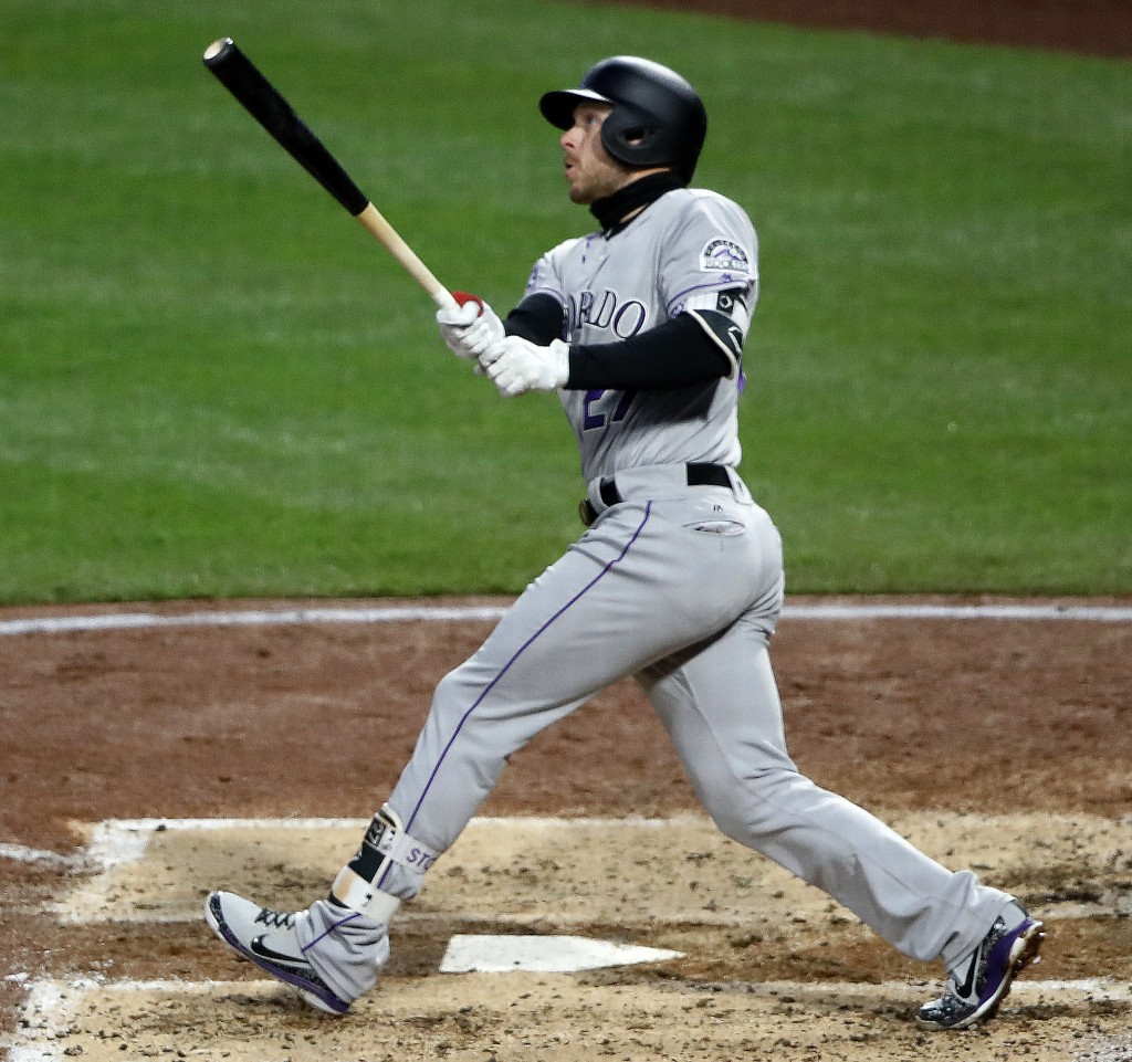 Colorado Rockies' Trevor Story (27) watches his three-run home run off Pittsburgh Pirates starting pitcher Steven Brault in the fourth inning of a bas