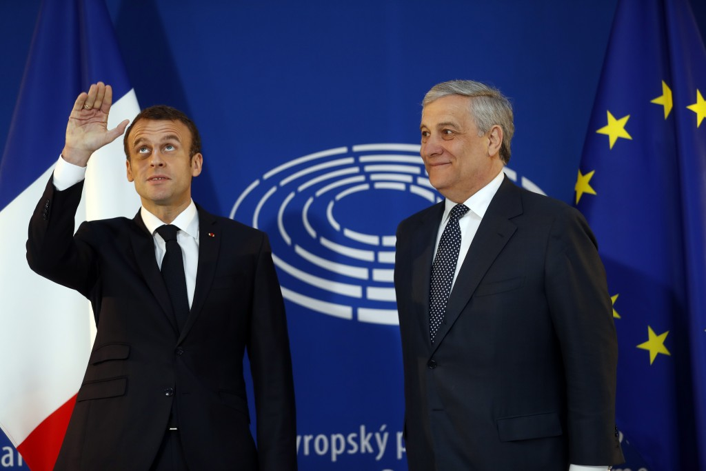 French President Emmanuel Macron, left, is welcomed by European Parliament president Antonio Tajani upon his arrival at the European Parliament in Str