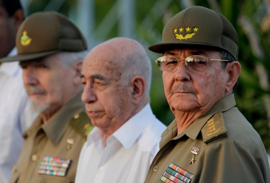FILE - In this July 26, 2009 file photo, Cuba's authorities, from right, President Raul Castro, Vice-President Jose Ramon Machado Ventura and Revoluti