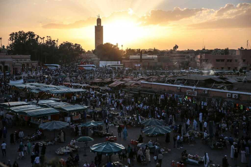 FILE - In this Saturday, Nov. 5, 2016 file photo, people gather in the landmark Jemaa el-Fnaa square, in Marrakesh, Morocco. A FIFA task force arrived