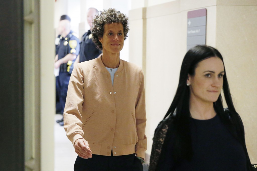Andrea Constand, left, returns to the courtroom after a lunch break during Bill Cosby's sexual assault retrial at the Montgomery County Courthouse in