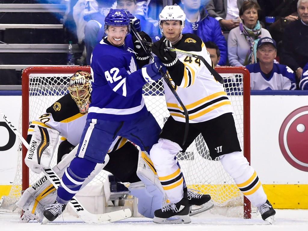 Boston Bruins goaltender Tuukka Rask (40) looks for the puck as Boston Bruins defenseman Nick Holden (44) and Toronto Maple Leafs centre Tyler Bozak (