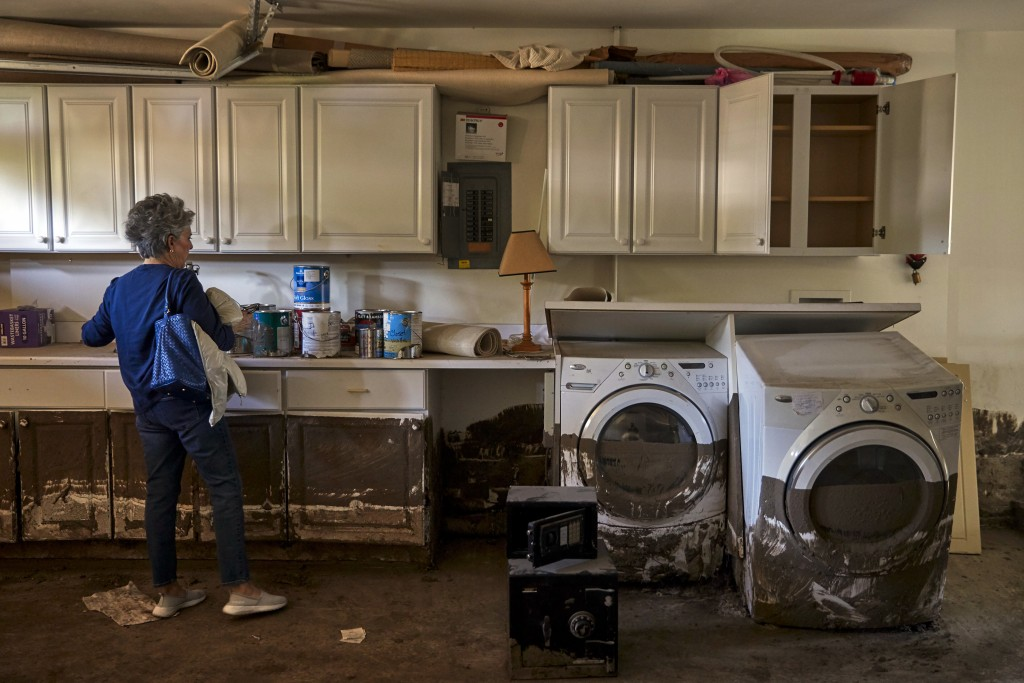 In this Wednesday, April 11, 2018, photo, mudslide survivor Mari Mitchel visits her home, which was heavily damaged in the mudslide, in Montecito, Cal