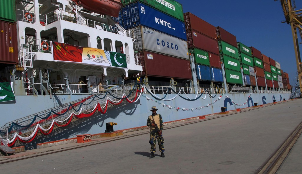 FILE - In this Nov. 13, 2016, file photo, a Pakistan Navy soldier stands guard while a loaded Chinese ship prepares to depart, at Gwadar port, about 7