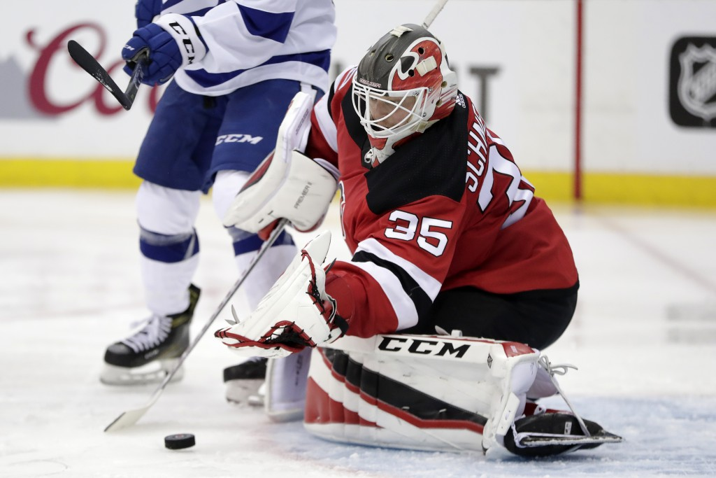 New Jersey Devils goaltender Cory Schneider blocks a shot from the Tampa Bay Lightning during the second period of Game 3 of an NHL first-round hockey