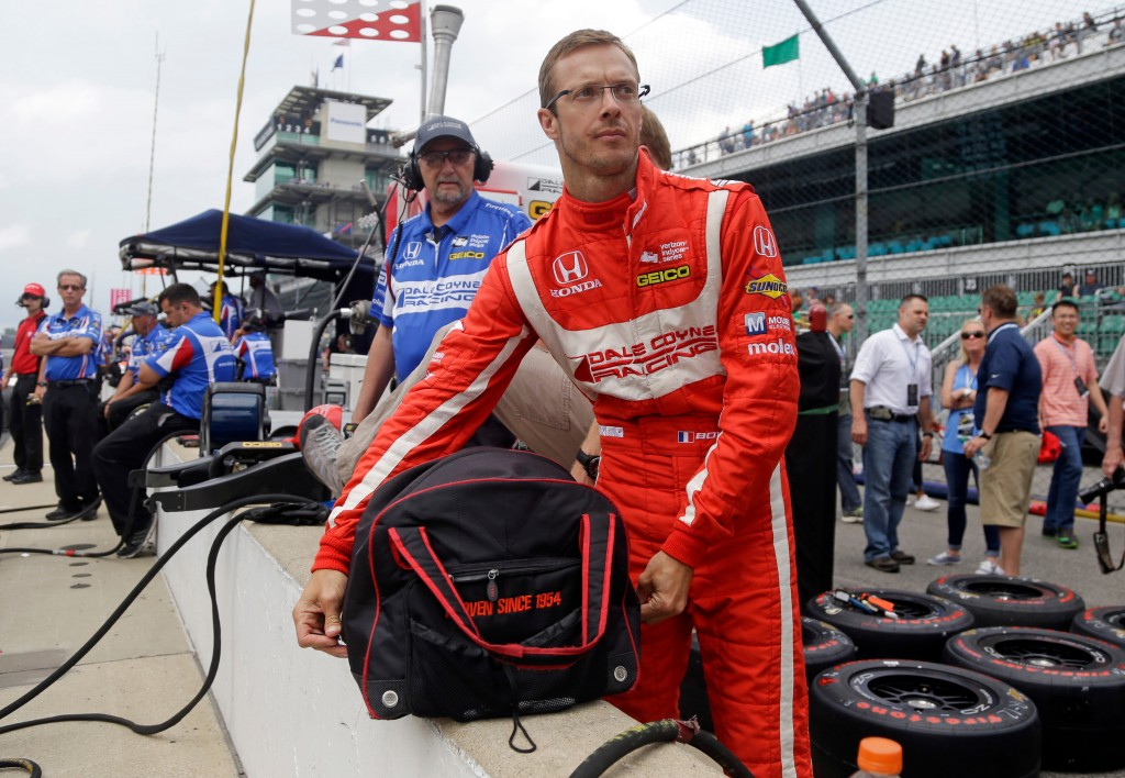FILE - In this May 19, 2017, file photo, Sebastien Bourdais, of France, unpacks his helmet as he prepares to drive during a practice session for the I