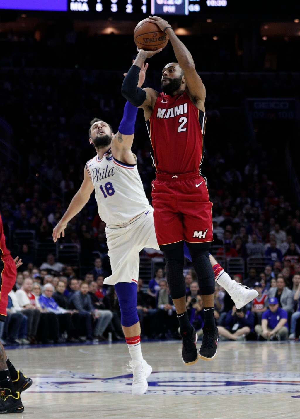 Miami Heat's Wayne Ellington, right, shoots with Philadelphia 76ers' Marco Belinelli, left, of Italy, defending during the first half in Game 2 of a f