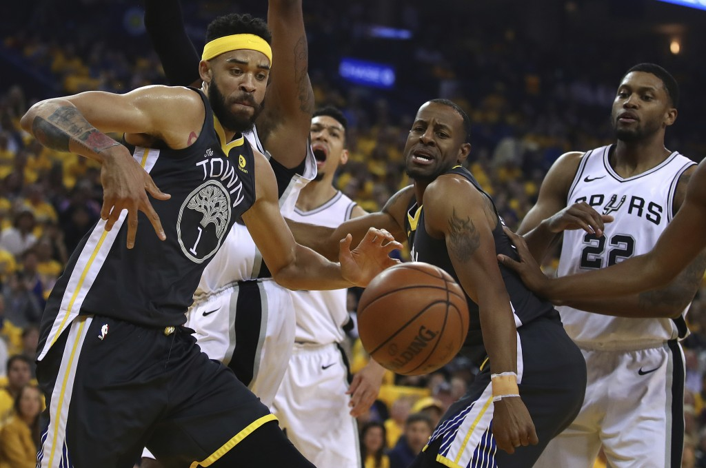 Golden State Warriors' JaVale McGee, left, and Andre Iguodala watch a loose ball beside San Antonio Spurs' Rudy Gay (22) during the first quarter in G