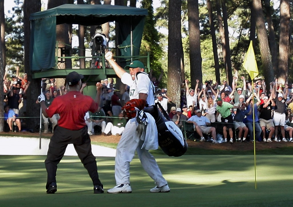 FILE - In this April 10, 2005, file photo, Tiger Woods celebrates with his caddie Steve Williams after his chip-in birdie on the 16th hole during the