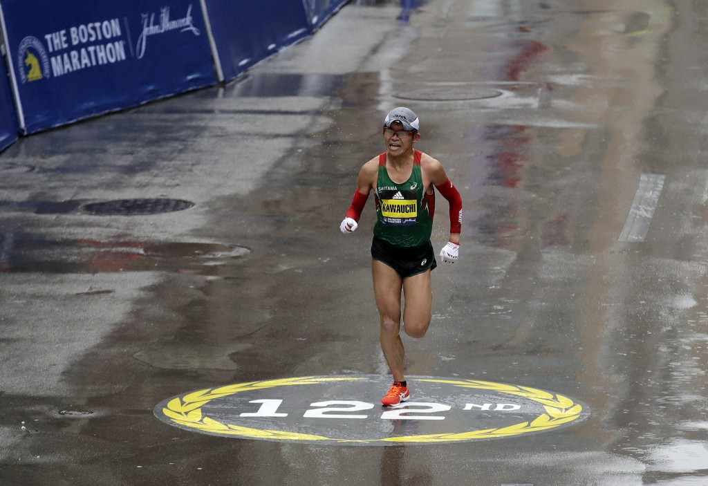 Yuki Kawauchi, of Japan, heads to the finish line to win the 122nd Boston Marathon on Monday, April 16, 2018, in Boston. He is the first Japanese man