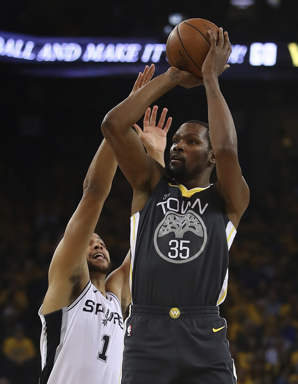 Golden State Warriors' Kevin Durant (35) shoots over San Antonio Spurs' Kyle Anderson, left, during the first quarter in Game 2 of a first-round NBA b