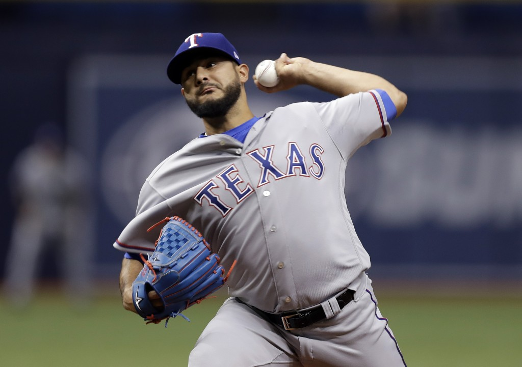 Texas Rangers starting pitcher Martin Perez delivers to the Tampa Bay Rays during the first inning of a baseball game Monday, April 16, 2018, in St. P
