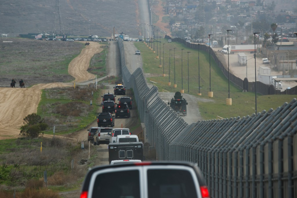 FILE - In this March 13, 2018, file photo, a motorcade carrying President Donald Trump drives along the border in San Diego. California has rejected t