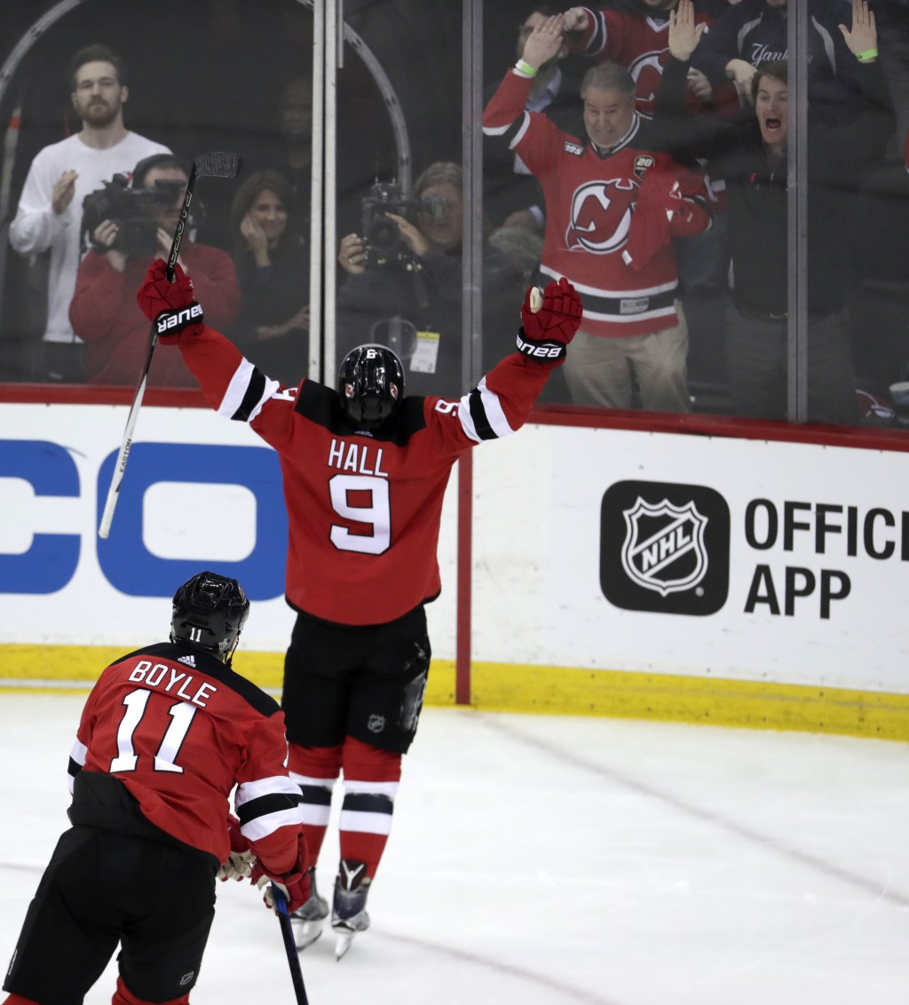 New Jersey Devils left wing Taylor Hall (9) celebrates after scoring a goal on the Tampa Bay Lightning during the second period of Game 3 of an NHL fi