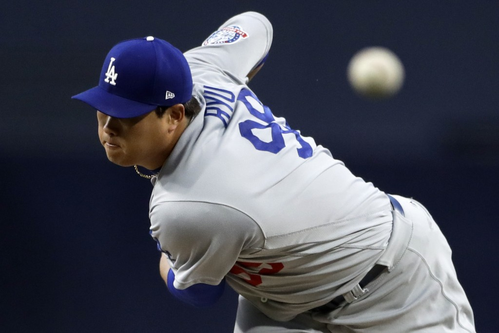 Los Angeles Dodgers starting pitcher Hyun-Jin Ryu, of South Korea, works against a San Diego Padres batter during the first inning of a baseball game,