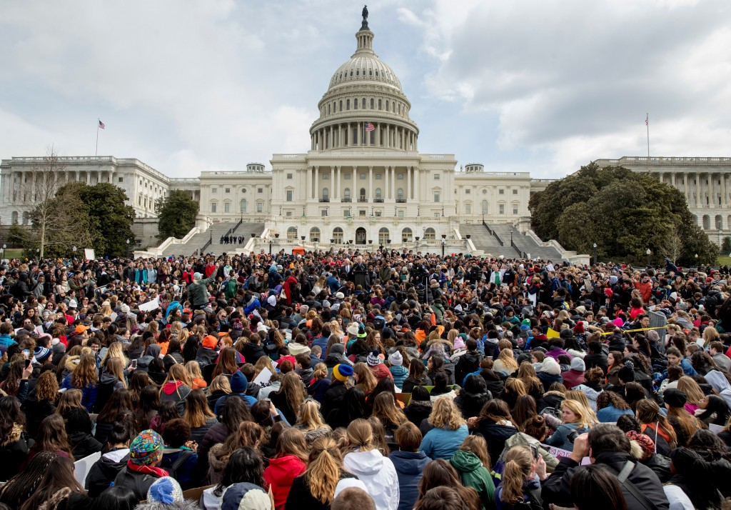 FILE- In this March 14, 2018, file photo, students rally outside the Capitol Building in Washington. Students risked disciplinary action at nearly 3,0