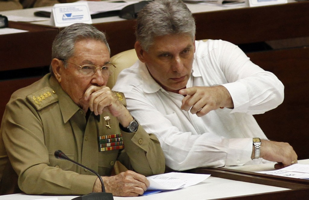 FILE - In this July 6, 2013 file photo, Cuba's President Raul Castro, left, and Vice President Miguel Diaz-Canel Bermudez attend the opening of a two-