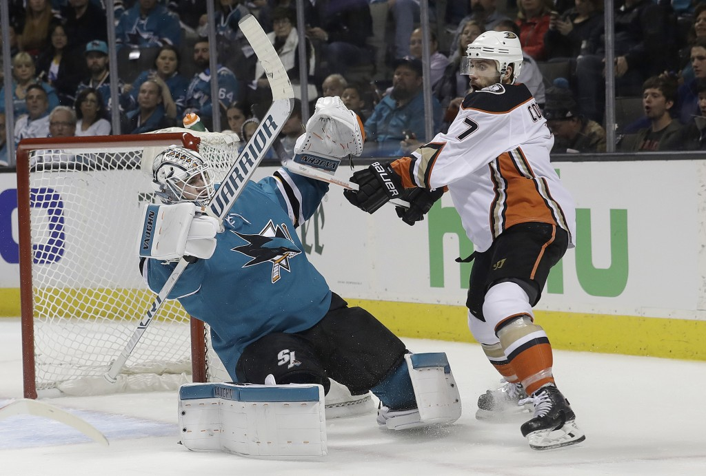 San Jose Sharks goalie Martin Jones, left, defends the goal against Anaheim Ducks left wing Andrew Cogliano (7) during the second period of Game 3 of