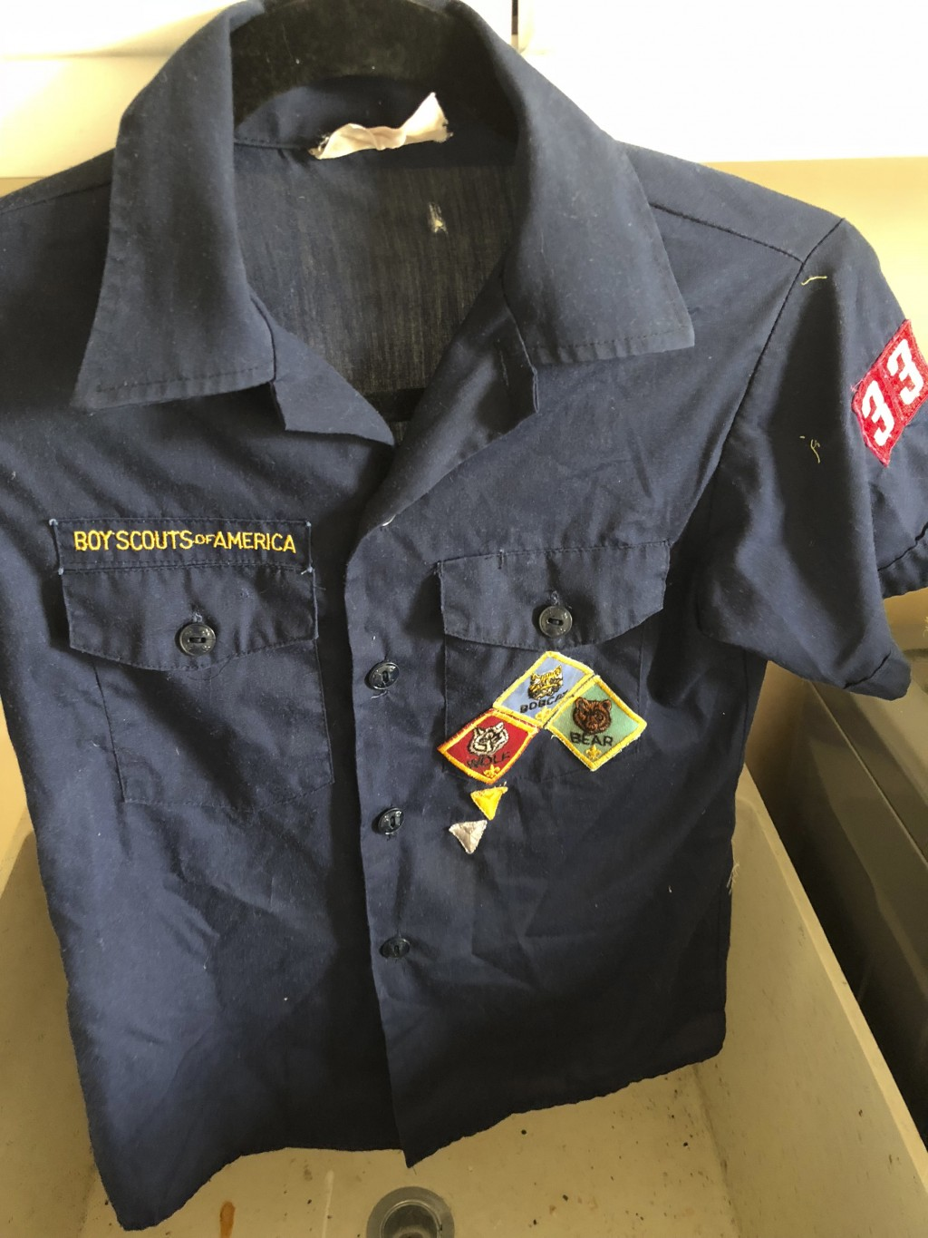 This Feb. 13, 2018, photo provided by Erin Doherty shows the Boy Scout uniform of a Montecito, Calif., mudslide victim, believed to be dead, after Doh