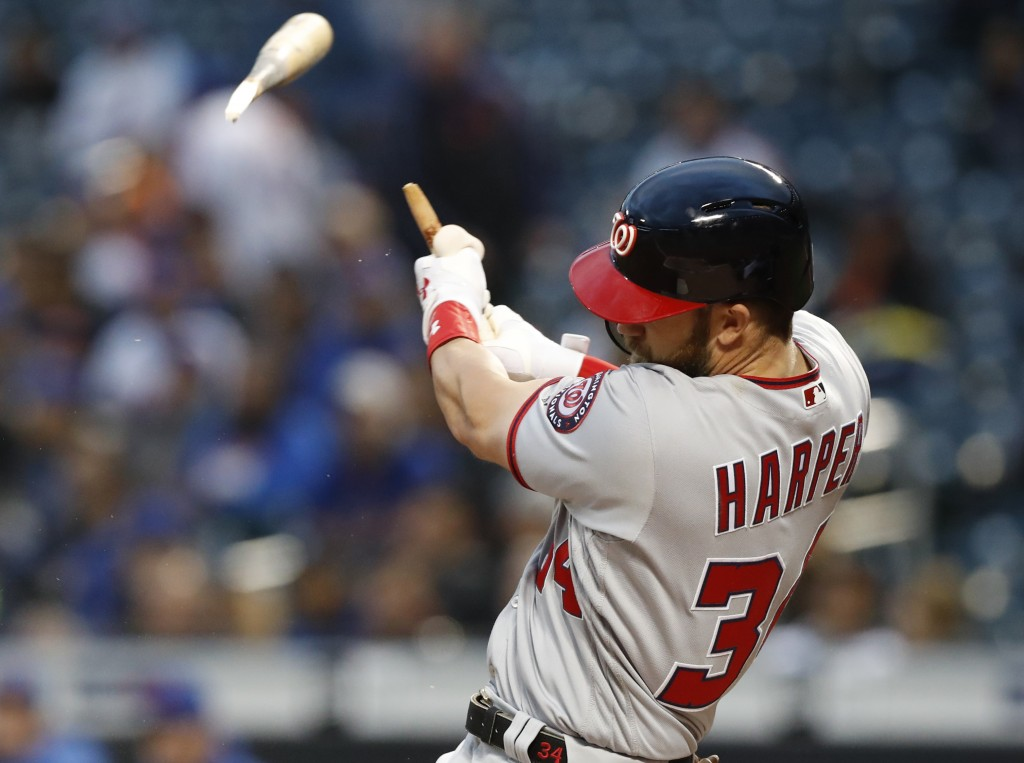 Washington Nationals' Bryce Harper hits a solo home run in the first inning of a baseball game against the New York Mets, Monday, April 16, 2018, in N