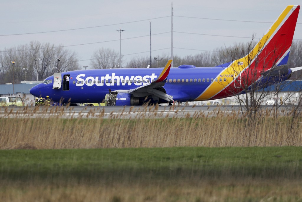 A Southwest Airlines plane sits on the runway at the Philadelphia International Airport after it made an emergency landing in Philadelphia, on Tuesday