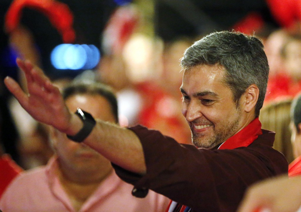 Presidential candidate Mario Abdo Benitez, of the Colorado Part,y waves to supporters during a campaign rally in Paraguari, Paraguay, Wednesday, April
