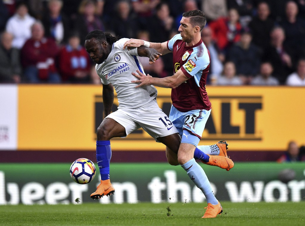 Chelsea's Victor Moses, left, and Burnley's Stephen Ward, during the English Premier League soccer match at Turf Moor, in Burnley, England, Thursday A...