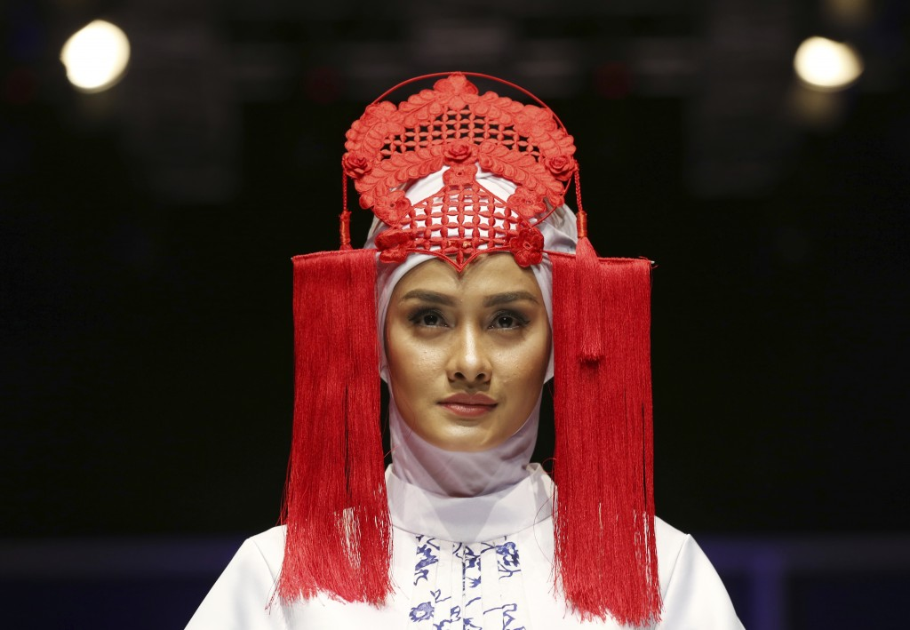 In this Friday, April 20, 2018, file photo, a model displays a creation by Ina Priyono during the Muslim Fashion Festival in Jakarta, Indonesia. The e...