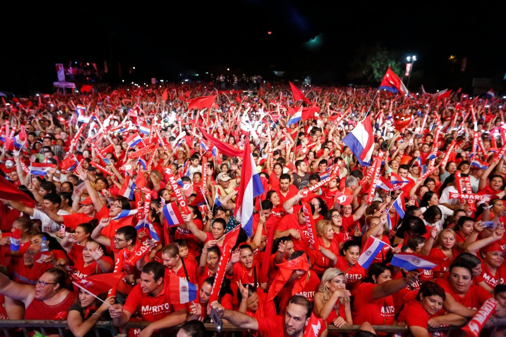 Supporters of presidential candidate Mario Abdo Benitez, of the Colorado Party, attends a campaign rally in Itagua Paraguay, Thursday, April 19, 2018.