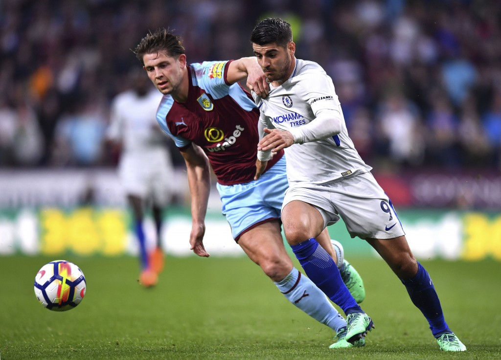 Burnley's James Tarkowski, left, chases the ball with Chelsea's Alvaro Morata during the English Premier League soccer match at Turf Moor, in Burnley,...