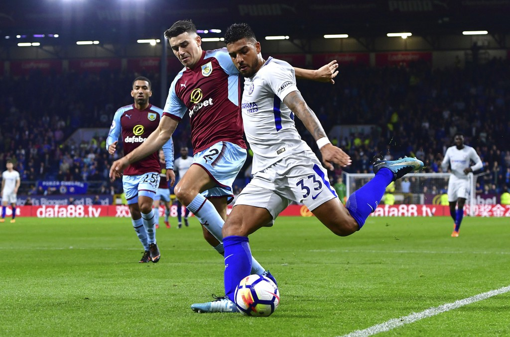 Burnley's Matthew Lowton, left, and Chelsea's Emerson Palmieri in action during the English Premier League soccer match at Turf Moor, in Burnley, Engl...