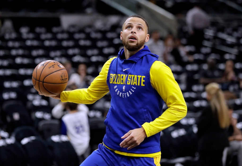 FILE - In this April 19, 2018 file photo, Golden State Warriors guard Stephen Curry (30) warms up before Game 3 of the team's first-round NBA basketba...