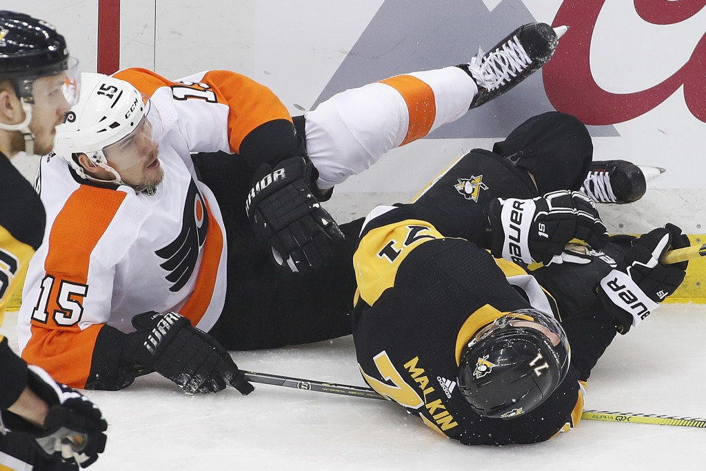Pittsburgh Penguins' Evgeni Malkin (71) and Philadelphia Flyers' Jori Lehtera (15) collide and slide into the boards during the first period in Game 5...
