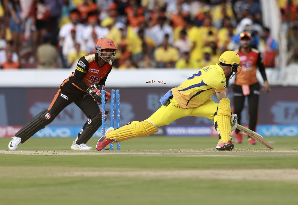 In this Sunday, April 22, 2018, file photo, Sunrisers Hyderabad wicket keeper Wriddhiman Saha dislodges the bails of Chennai Super Kings' Faf du Pless...