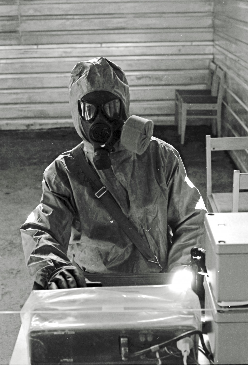 In this photo taken on on Oct. 4, 1987, A Soviet army serviceman in protective suit handles toxic substances during a visit by Western diplomats and j...