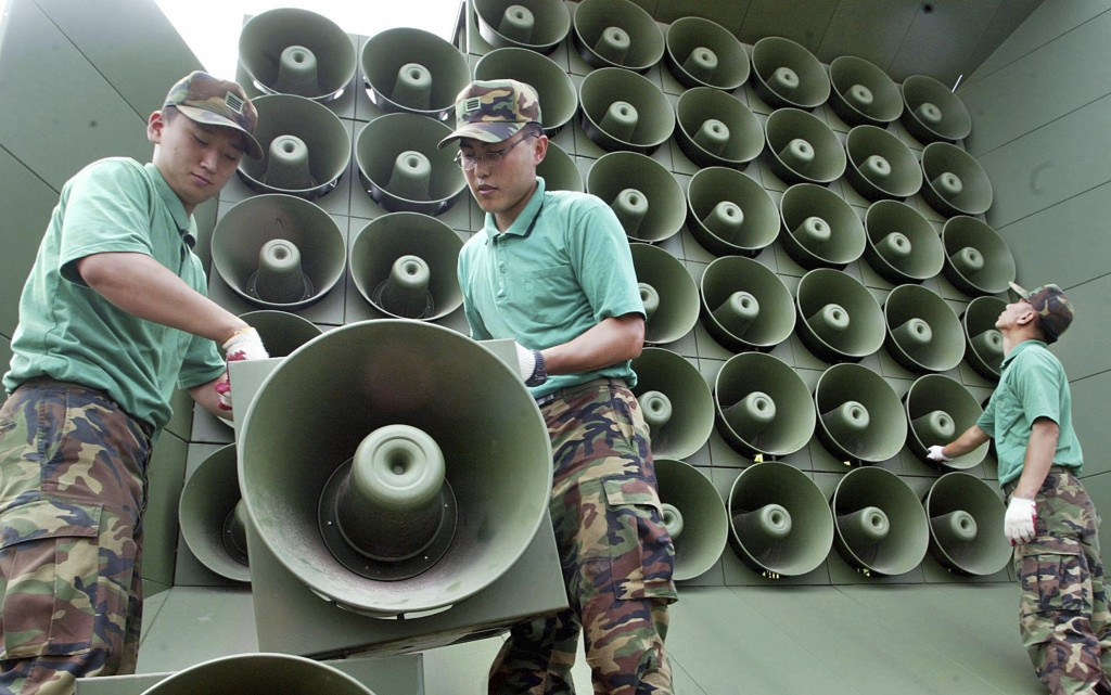 FILE - In this June 16, 2004 file photo, South Korean army soldiers remove loudspeakers used for propaganda near the demilitarized zone between South ...